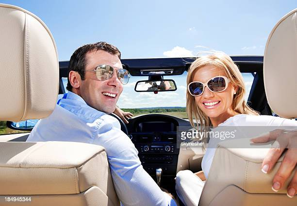 Attractive Couple in a Convertible Car