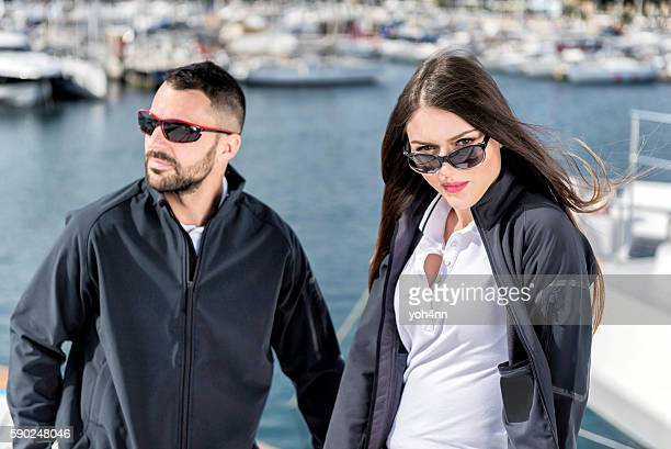 Attractive couple on luxury yacht