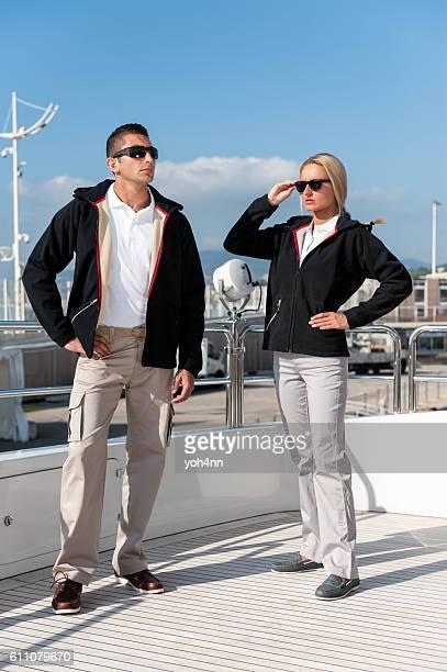 Attractive couple posing on luxury yacht