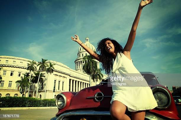 Attractive cuban woman posing by the El Capitolio