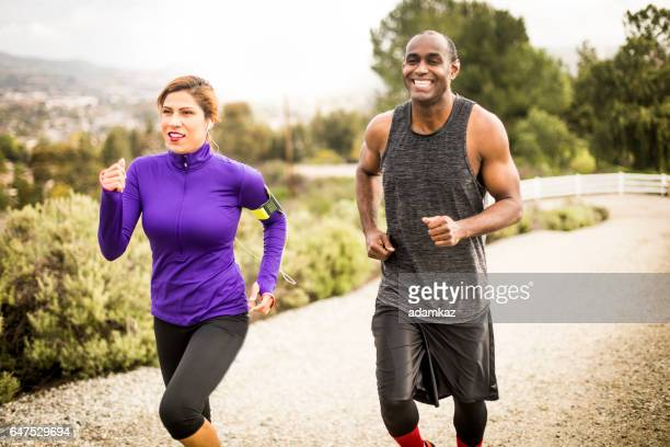 attractive diverse couple working out - california strong stock photos and pictures