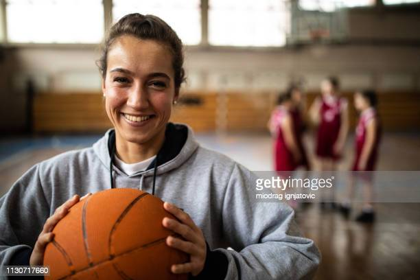 attractive female basketball coach - basketball sport stock pictures, royalty-free photos & images