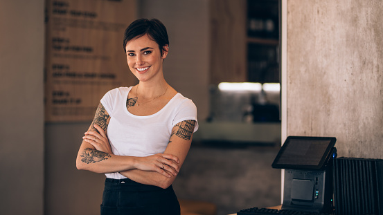 Attractive female cafe owner 956559604