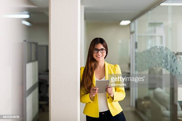 attractive female executive using a tablet computer - mexican business women stock photos and pictures