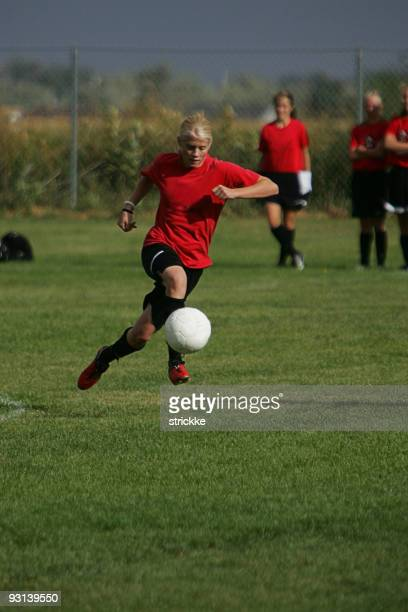 Attractive Female Foots Ball in air for Dynamic Dribble