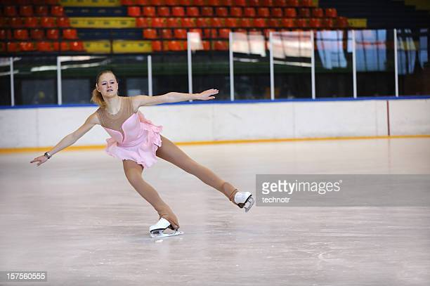 attractive female ice dancing - figure skating stock pictures, royalty-free photos & images