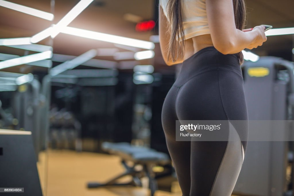 Attractive female in a gym in a hot pants : Stock Photo