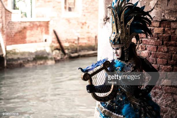 attractive female posing in venice carnival costume - venice carnival stock pictures, royalty-free photos & images