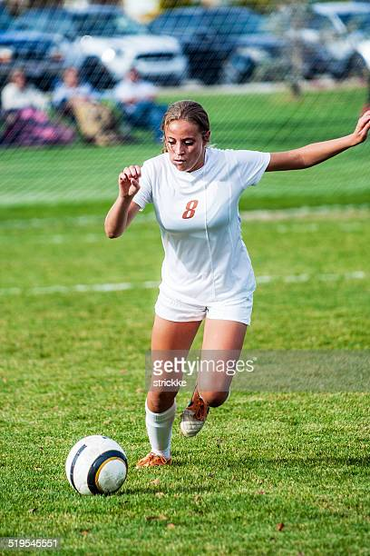 attractive female soccer player on power kick approach - girl chest stock photos and pictures