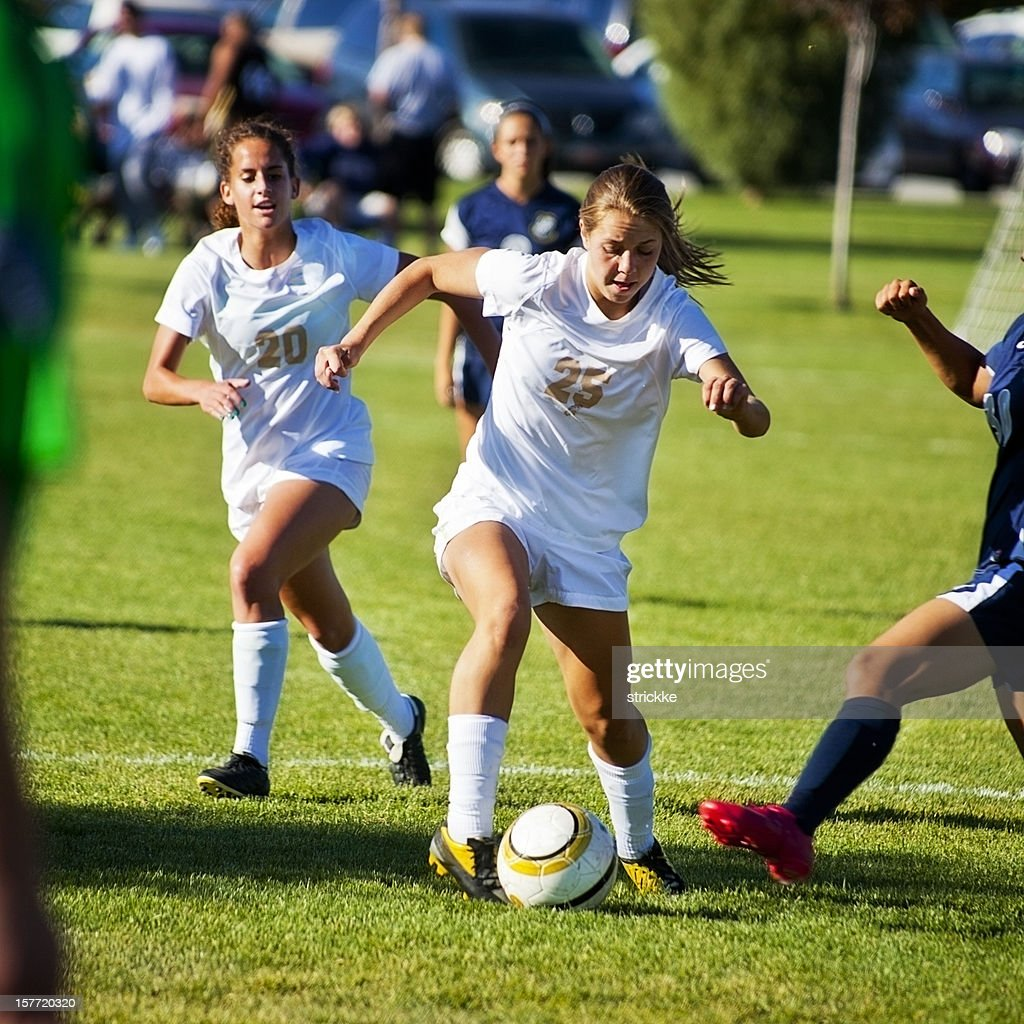 Attractive Female Soccer Players Compete for Control of Ball : Stock Photo