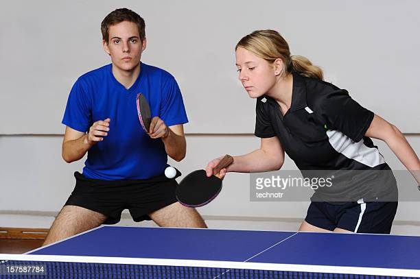 Attractive female table tennis player serving