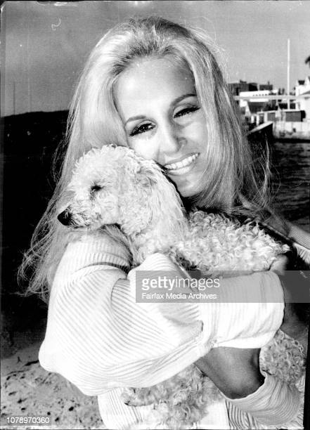 Attractive Germen actress Liane Parker of Point Piper frollicks with her French toy poodle Jacques at Lady Martin beach today Liane who has been in...