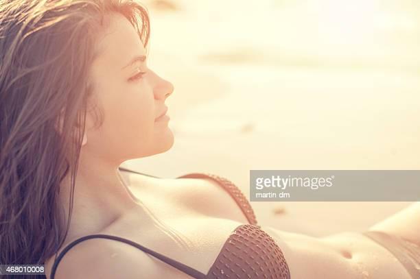 Attractive girl sunbathing at the beach