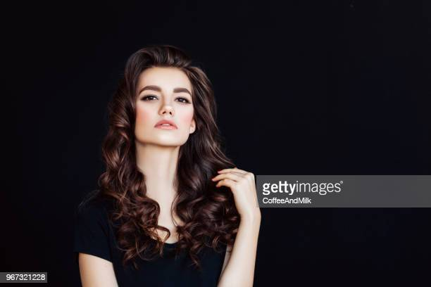attractive girl with shiny and curly hairstyle - big hair stock pictures, royalty-free photos & images