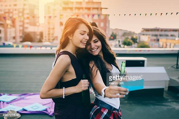Attractive girls taking selfie on the rooftop