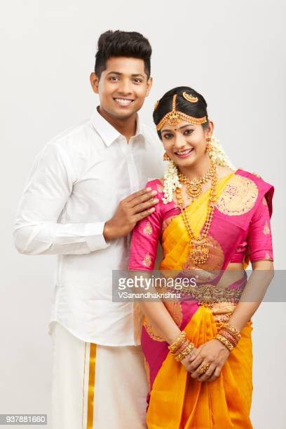 Attractive happy south Indian couple in traditional dress