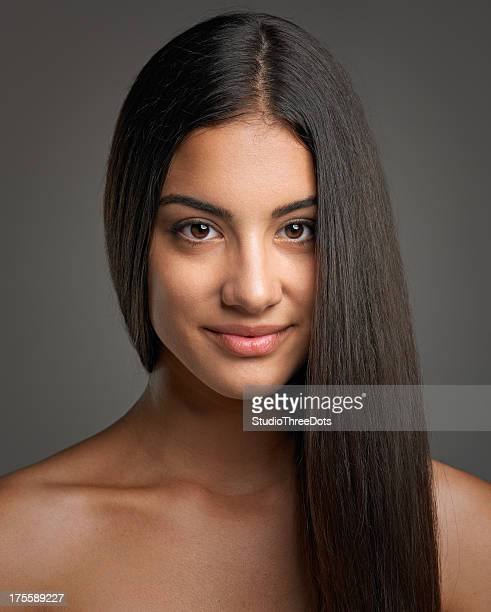 attractive happy young woman with staright long hair