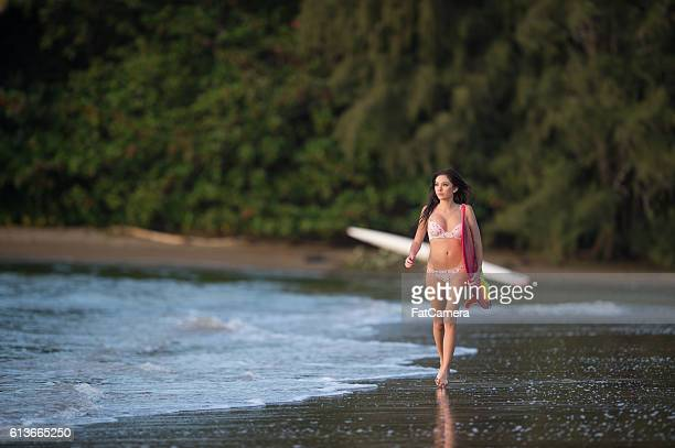 attractive hawaiian female surfer at the beach - polynesian culture stock photos and pictures