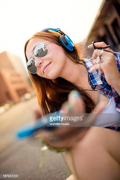 Attractive hipster with headphones in city