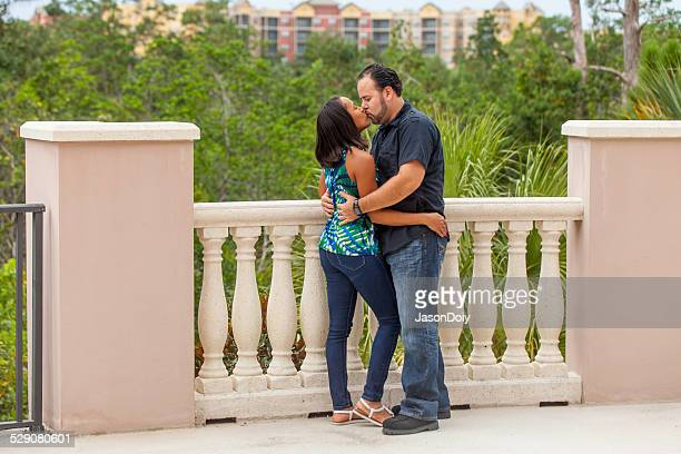 attractive hispanic couple kissing - kissing on the mouth stock photos and pictures