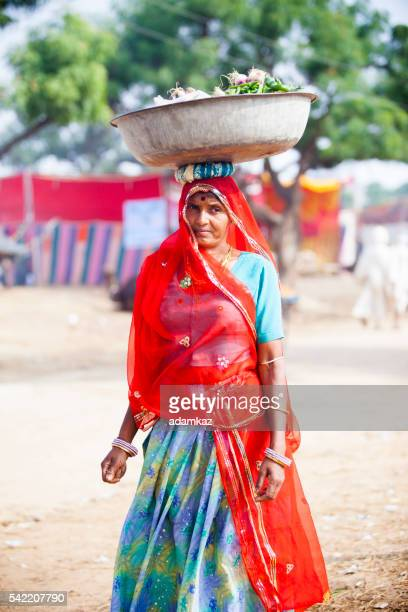 Attractive Indian Woman Carrying Food in Basket on Head