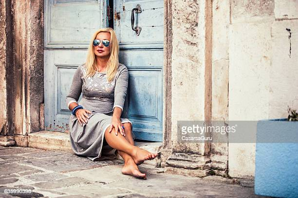 Attractive Lady Posing in front the Home Entrance