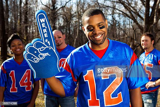 attractive male football fan - foam finger stock photos and pictures