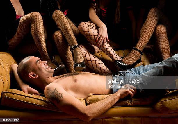 attractive man among sexy ladies - men wearing stockings stock photos and pictures