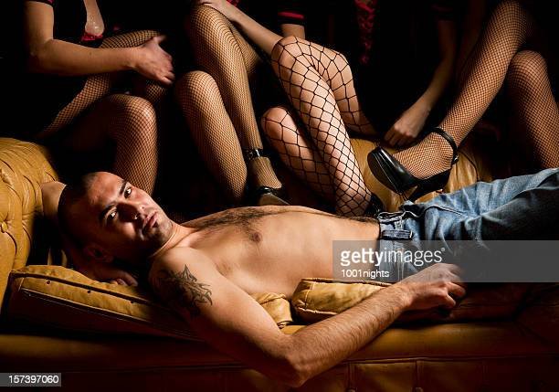 attractive man among sexy ladies