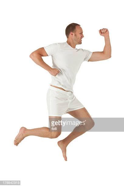 homem atraente em acção - descalço imagens e fotografias de stock