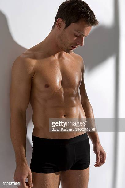 attractive man in black underpants - boxershort stock pictures, royalty-free photos & images