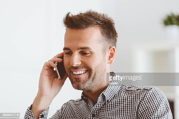 Attractive man talking on cell phone