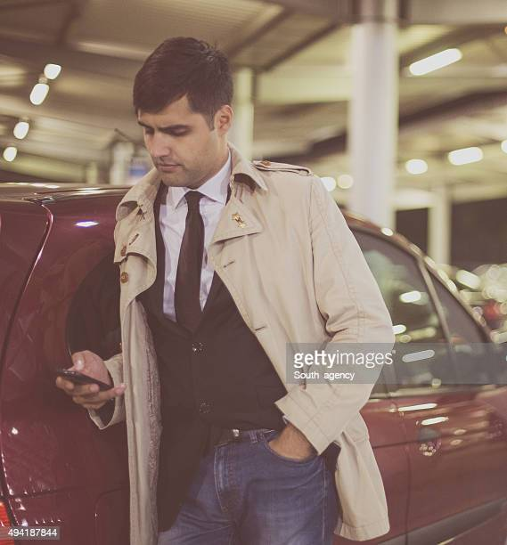 Attractive man typing on his smart phone