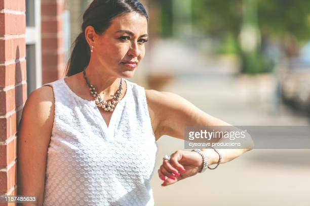 Attractive Mature Adult Business Woman in an Urban Downtown Commerce District in Western Colorado