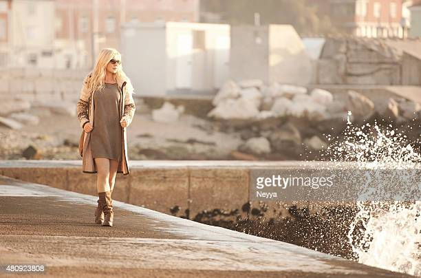 Attractive Mature Woman In Woolen Clothings Walking