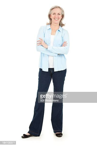 Attractive Mature Woman Standing With Arms Crossed