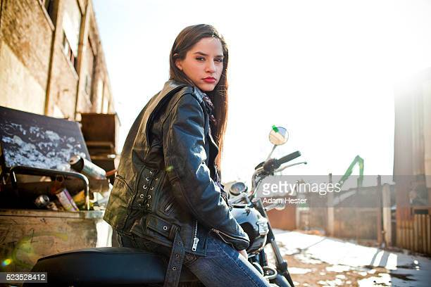attractive mid adult woman posing on motorbike - leather jacket stock pictures, royalty-free photos & images