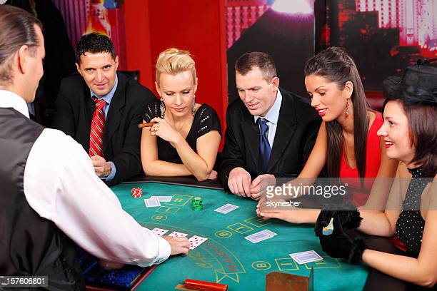 Attractive people having fun at the Blackjacks table.