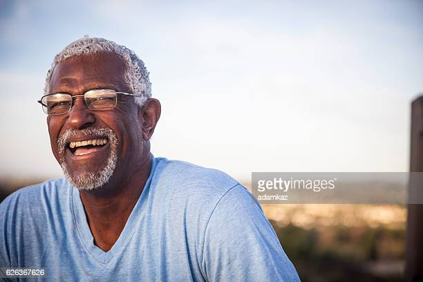 attractive senior black man outdoor portrait - black people laughing stock photos and pictures