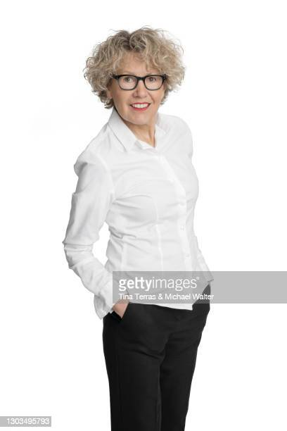 attractive senior business woman smiling at the camera, isolated on white background. - white shirt stock pictures, royalty-free photos & images