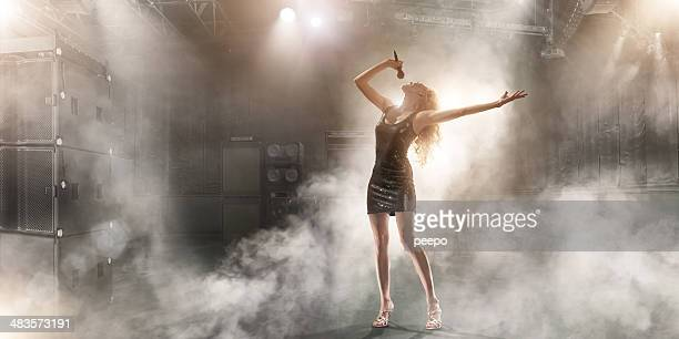 attractive singer performing on stage - singer stock pictures, royalty-free photos & images