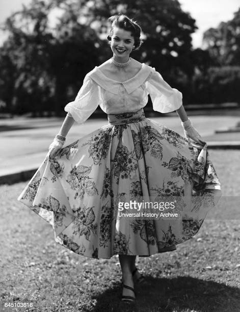 Attractive skirt with a cummerbund waistband is in a new printed nylon taffeta showing a delicate black design on a caramel ground It is worn with a...