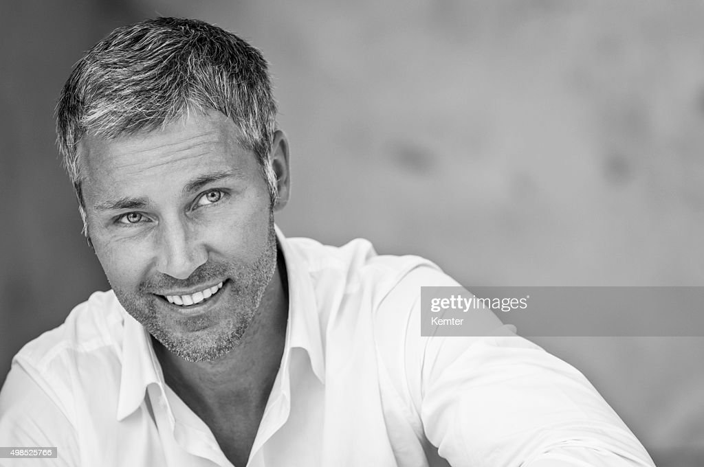 attractive smiling man looking up : Stock Photo
