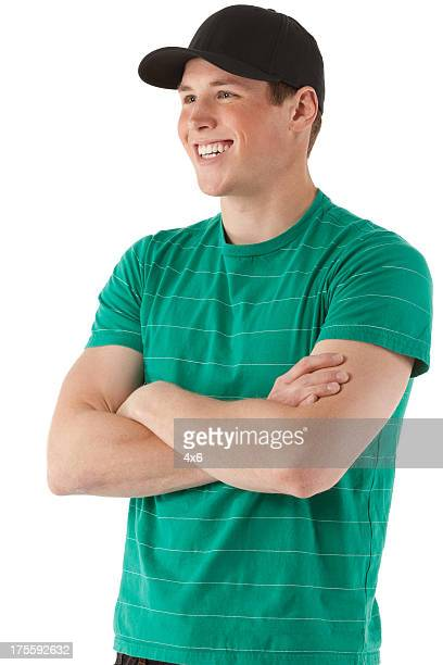 Attractive smiling man standing with arms crossed