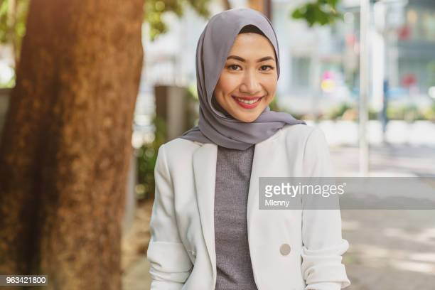 Attractive smiling young malaysian woman in kuala lumpur