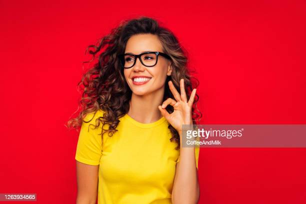 attractive smiling young woman - t shirt stock pictures, royalty-free photos & images