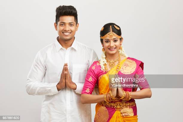 Attractive south Indian couple greeting namaste in traditional dress