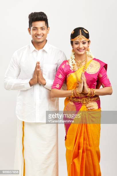 attractive south indian couple greeting namaste - traditional clothing stock pictures, royalty-free photos & images