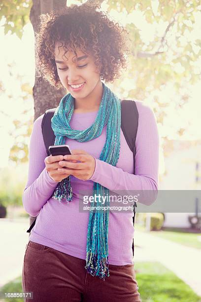 Attractive student texting