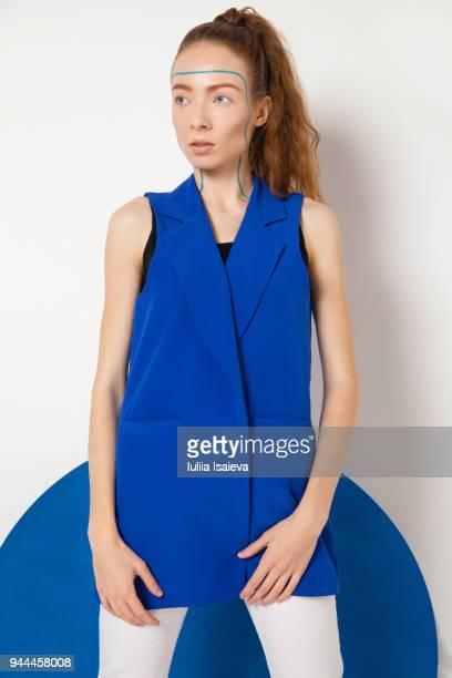 Attractive stylish woman at blue circle